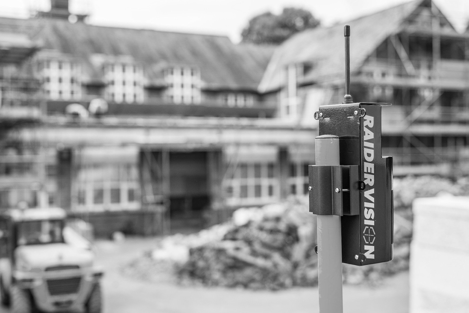 Black and white image of a RaiderVision alarm unit protecting a building site