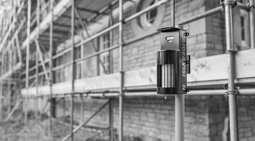 Black and white image of a RaiderVision security alarm on a scaffolding site